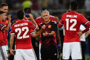 Jose Mourinho issues instructions during the water break.