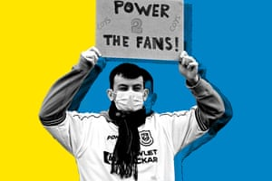 A fan holds a sign reacting to the collapse of the planned creation of a European Super League,