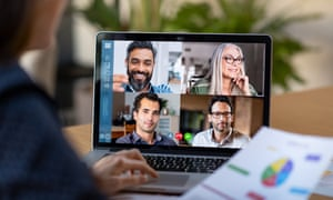 Back view of business woman talking to her colleagues about business plan in video conference. Multiethnic business team using laptop for a online meeting in video call. Group of businessmen and businesswomen smart working from home.