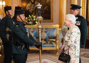 London, UKBritain's Queen Elizabeth II inspects the Queen's Truncheon, the ceremonial staff carried by the Royal Gurkha Rifles regiment, during an audience at Buckingham Palace