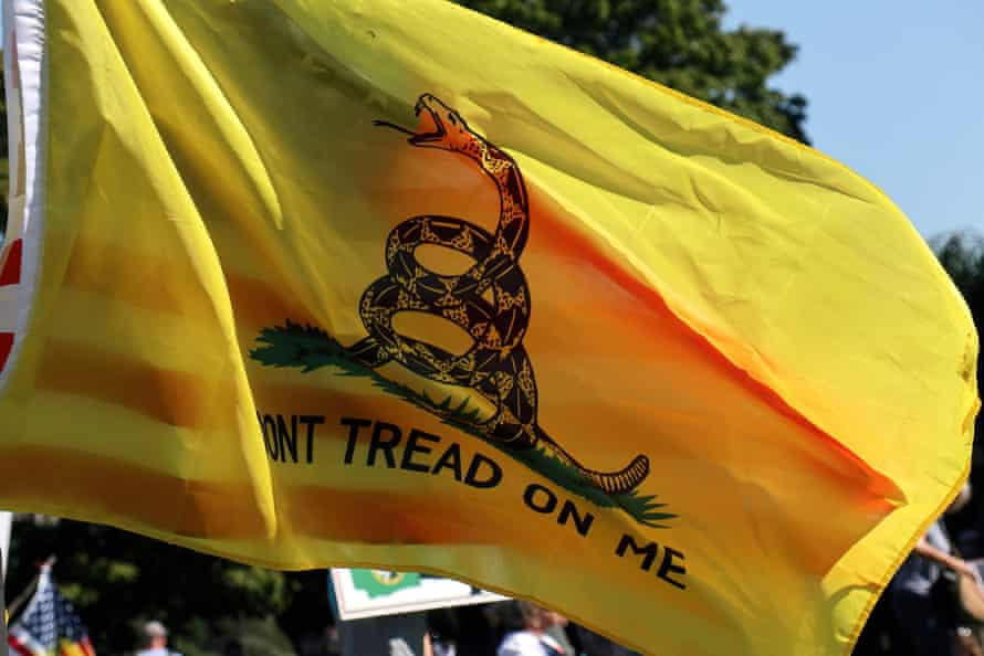 Anti COVID-19 vaccine mandate in Olympia, US - 28 Aug 2021Mandatory Credit: Photo by Toby Scott/SOPA Images/REX/Shutterstock (12381489a) A yellow flag with a snake at a protest against a recently imposed COVID-19 vaccine mandate for some public employees in the state of Washington. Anti COVID-19 vaccine mandate in Olympia, US - 28 Aug 2021