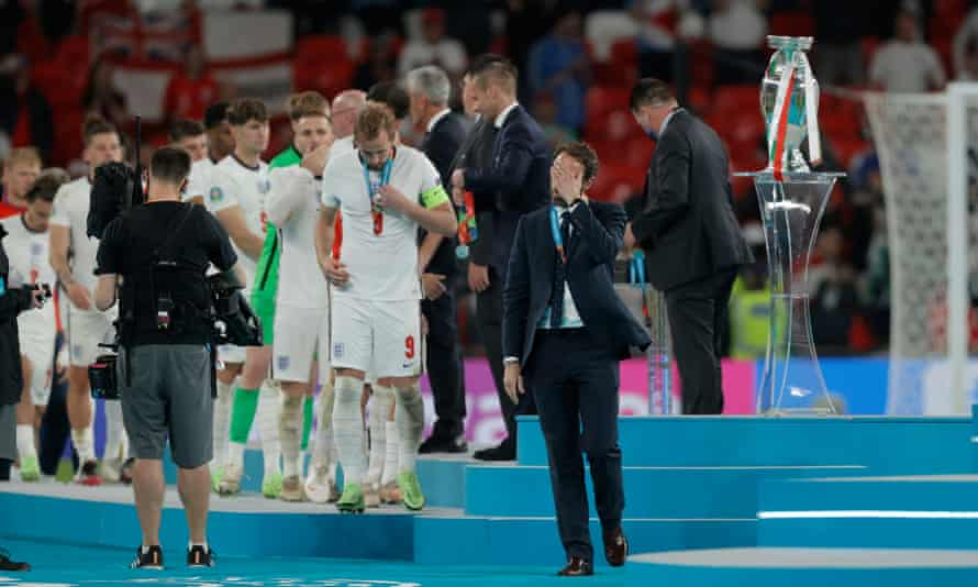 Gareth Southgate leads the way as England collect their runners-up medals.