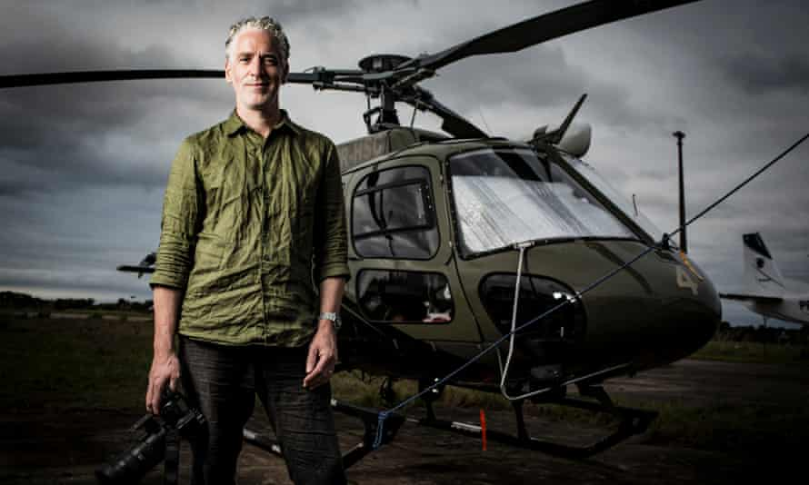 Gordon Buchanan and helicopter in Equator from the Air.
