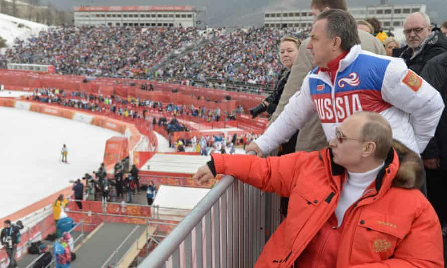 Putin watches downhill skiing at the Winter Paralympics in Sochi.