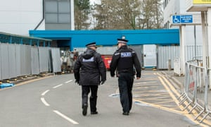 Police outside the buildings at Arrowe Park hospital in Wirral