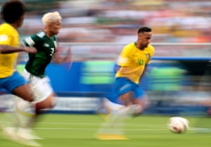 Mexico's Carlos Salcedo chases Neymar on his way to scoring the opening goal helping Brazil win 2-0.