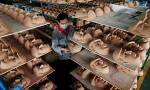 A factory producing Trump masks in Zhejiang province. 'Both sides should try to be friends and partners, rather than opponents or enemies,' the Chinese foreign ministry said.