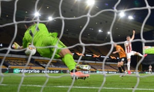Wolves goalkeeper Rui Patricio (left) saves a header from Ahmed Hassan.