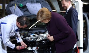 German Chancellor Angela Merkel visits Volkswagen's car factory in Zwickau, eastern Germany, as it starts production of the new Volkswagen electric car, the ID.3 model.