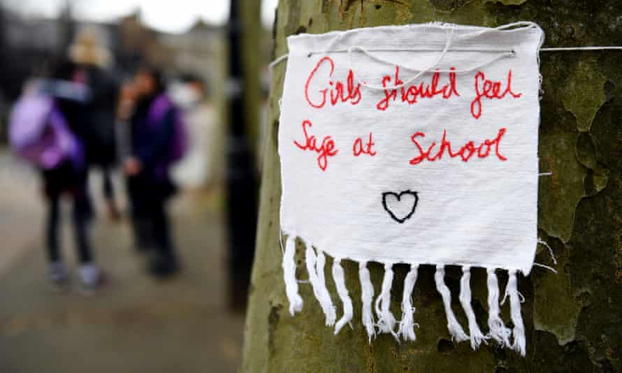 A hand-stiched note tied to a tree reading: 'Girls should feel safe at school'