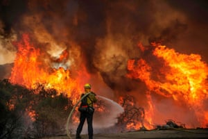 San Miguel county firefighters battle a brush fire along Japatul Road during the Valley fire in Jamul