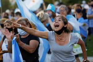 "A woman shouts to the Casa Rosada Presidential Palace during a protest against the government over a ""VIP"" queue jumping vaccine scandal in Buenos Aires, Argentina, on 27 February, 2021."