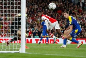 Eddie Nketiah scores the third for Arsenal.