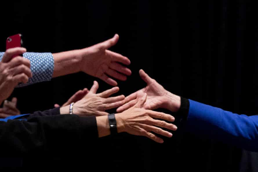Hillary Clinton shakes hands with attendees during a campaign stop.