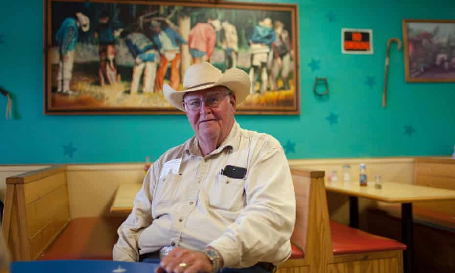 WR Low, 75, a retired rancher, poses at the Cow Patty, a restaurant in Gonzales, Texas. Low is opposed to O'Rourke.