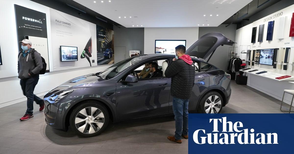 Tesla reports record quarterly profit as electric car sales boom