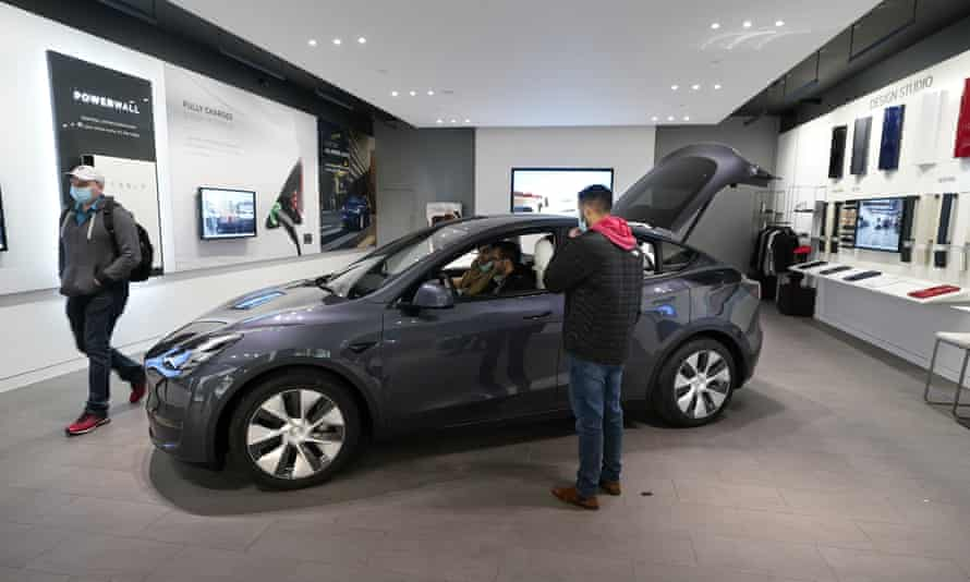 A Tesla Model Y Long Range is displayed at the Tesla Gallery in Troy, Michigan, in February. Sales of the Model Y and demand in China have boosted Tesla's fortunes.