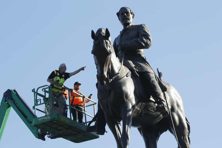 A crew from the Virginia department of general services inspect the statue of the Confederate general Robert E Lee on Monument Avenue in Richmond, Virginia, last year.