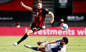 Jack Stacey hurdles Blackburn's Derrick Williams during Bournemouth's win in September. The team are unbeaten in the Championship.