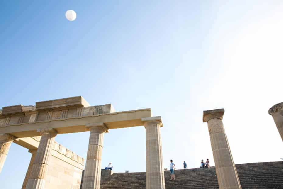Tourists visiting an archeological site in Lindos, Rhodes.