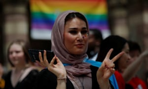 Ati, who is a Muslim and transgender, waits for the start of Boston's 48th Pride Parade