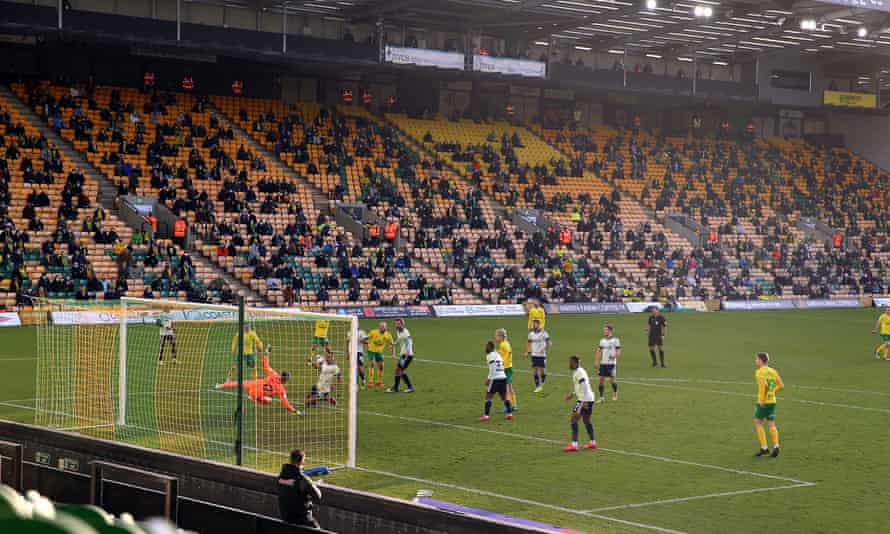 A socially distanced, restricted, crowd watch Norwich take on Cardiff in December 2020