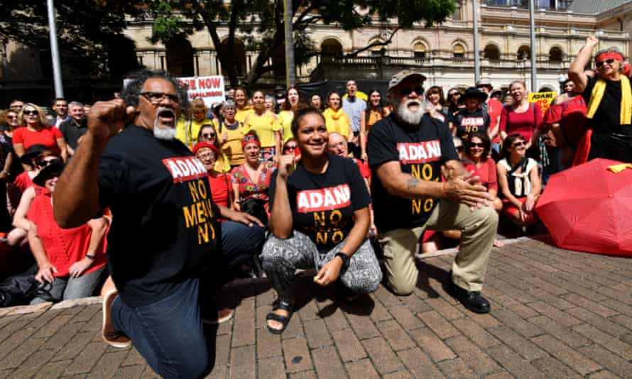 Wangan and Jagalingou traditional owners and supporters protest in 2018. They oppose extinguishing native title for Adani's Carmichael coalmine