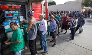 People queue outside a store in Hawthorne, California, to buy a lottery ticket