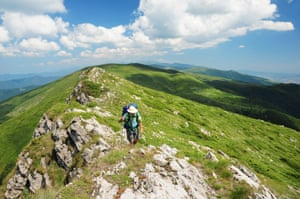 Hiker on summer mountain path inCentral Balkan national park, Bulgaria