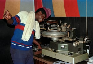 """Squingine """"Squingey"""" Francis with a vinylium dubcutter, which he used to cut records for Channel One"""