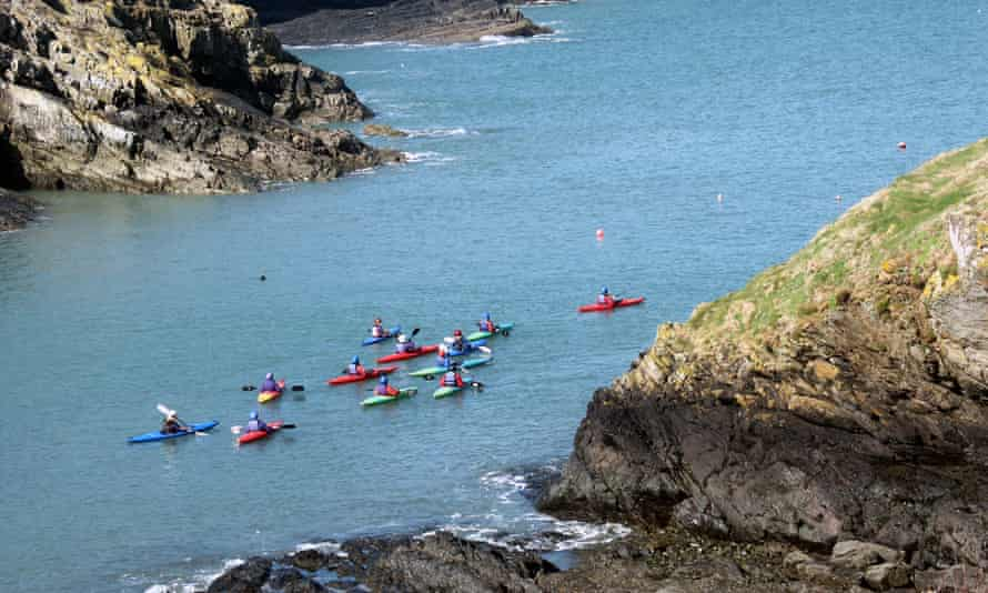 Canoeists off the Pembrokeshire coast close to the eco lodge accommodation of Preseli Venture