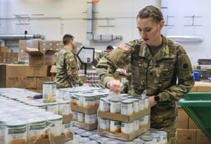 Members of the Ohio National Guard help to pack food and supplies for those in need at the Mid Ohio Foodbank in Columbus. Due to the ongoing Coronavirus pandemic and rising unemployment, the demand placed on foodbanks around the United States has grown rapidly.