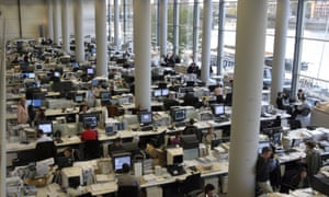 People in a large open plan office