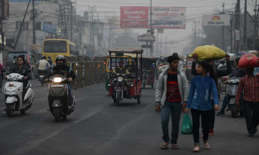 Traffic moves through a smoggy area of the northern Indian city of Moradabad