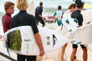 Surfers competing in the Sydney Surf Pro participate in a paddle-out, wreath laying and observe a minute of silence to remember victims of the Christchurch mosque attacks at Manly Beach on Sunday afternoon.