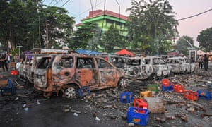 Cars burned by protesters in Jakarta