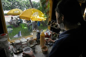 A worker making coffee in a train carriage converted into a cafe at a railway station in Phnom Penh.