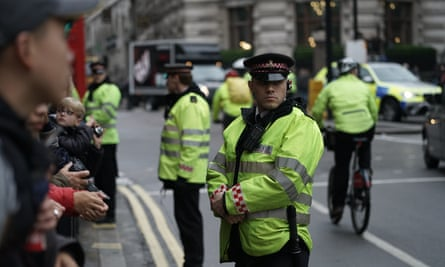 Police stand guard at Mansion House before Xi Jinping's arrival on Wednesday.