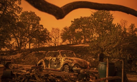 A Volkswagen Beetle scorched by the Carr Fire rests at a residence in Redding, California, Friday, July 27, 2018.