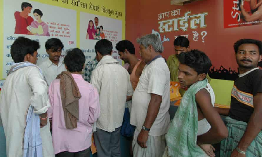 Men queue at a family planning clinic in India