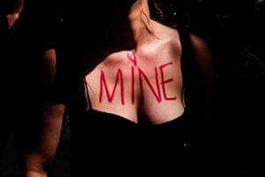 "The chest of a protester is seen with the words ""mine"" in Sydney, Australia."