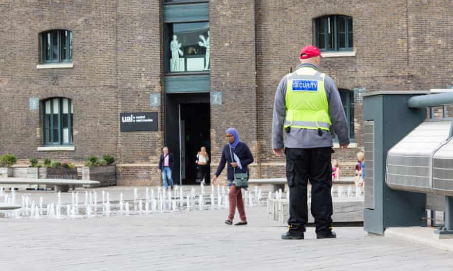 Pseudo-public space … a private security guard in Granary Square, King's Cross.