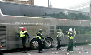 Bottles are thrown at the Manchester United team bus.