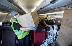Personal protective equipment is unloaded from a plane in Bournemouth, UK, after arriving from China