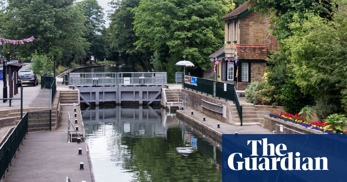 Search for boy in Thames two miles from where woman's body was recovered