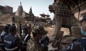 Nepalese soldiers line up to clear rubble of temples at Patan's Durbar Square.