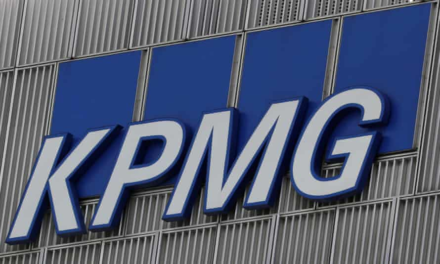 KPMG logo is seen at their offices at Canary Wharf