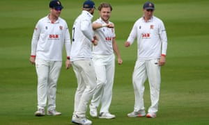 Essex's Sam Cook celebrates with teammates after taking the wicket of Somerset's Tom Lammonby.