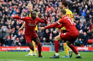 Sadio Mane celebrates before the goal is ruled offside by VAR.