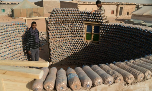 The house that Tateh built     out of sand-filled plastic bottles